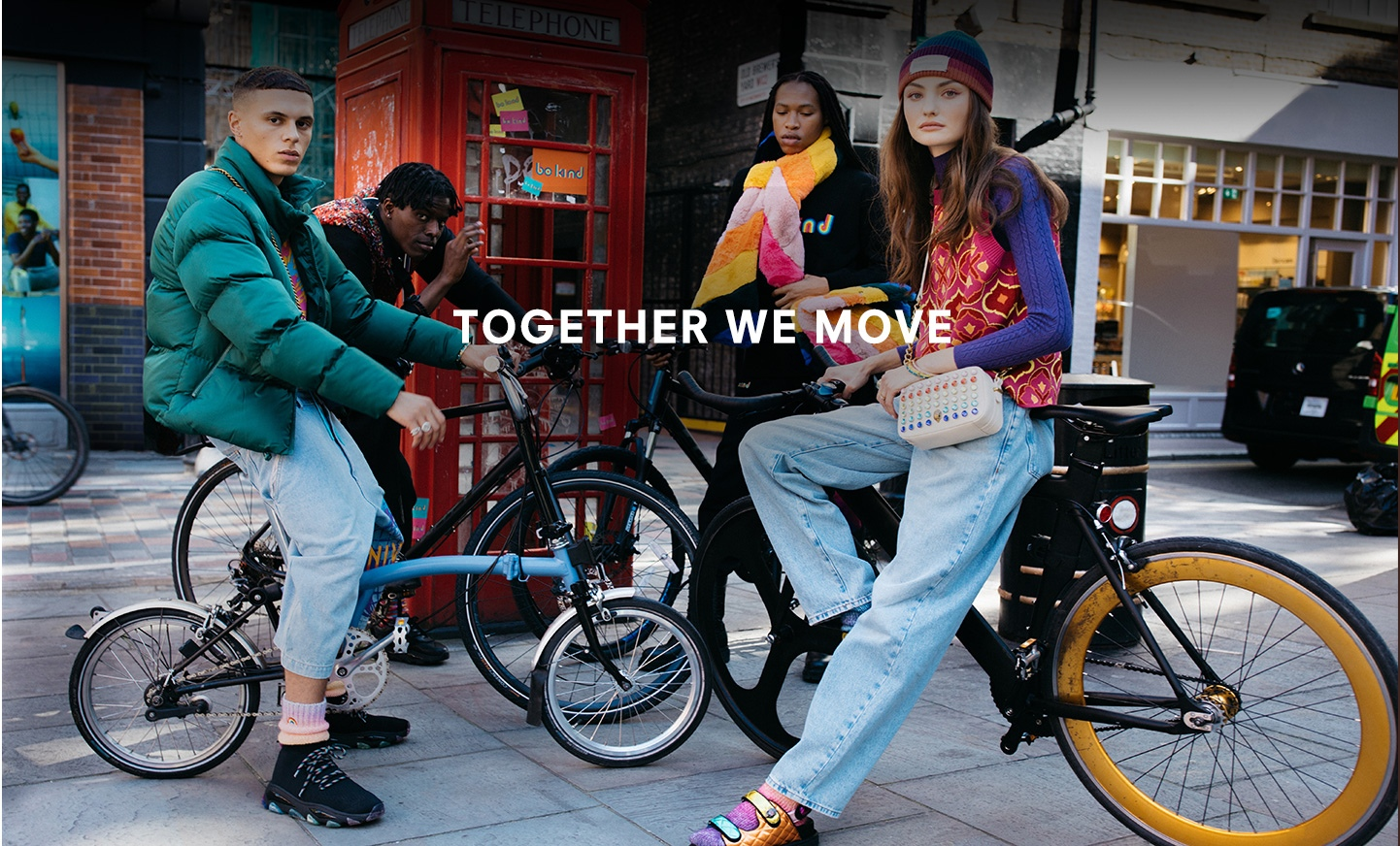 Together We Move Group Image Infront of Telephone Box.