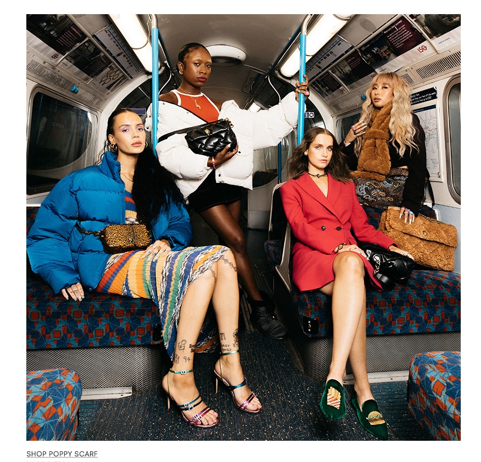 Image shows ladies on tube modelling Kurt Geiger in particular the Poppy Scarf and Pierra Heel